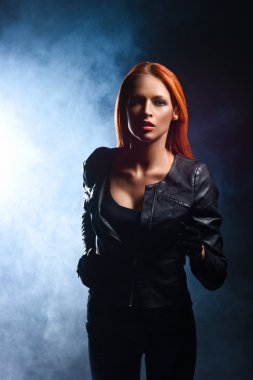 redhead woman in a black leather jacket