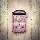 Vintage Mail Box on Stone Wall
