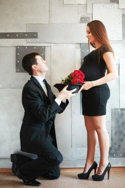 Stylish elegant young couple waiting a baby