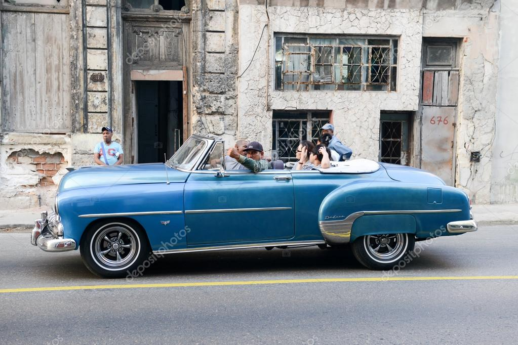 Person driving his vintage car at Old Havana – Stock Editorial Photo ...