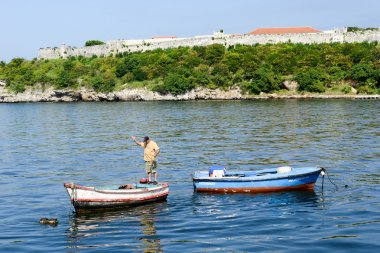 Fisherman on his boat in the bay of Havana