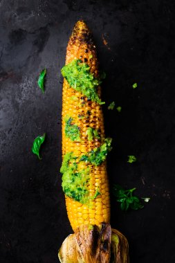 corn a grill with pesto sauce on