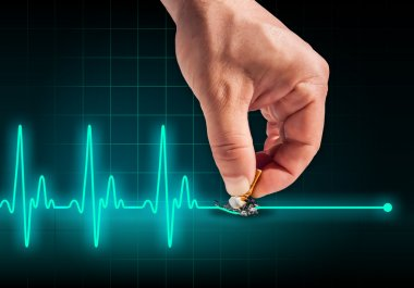 Hand putting out cigarette on heart beat line
