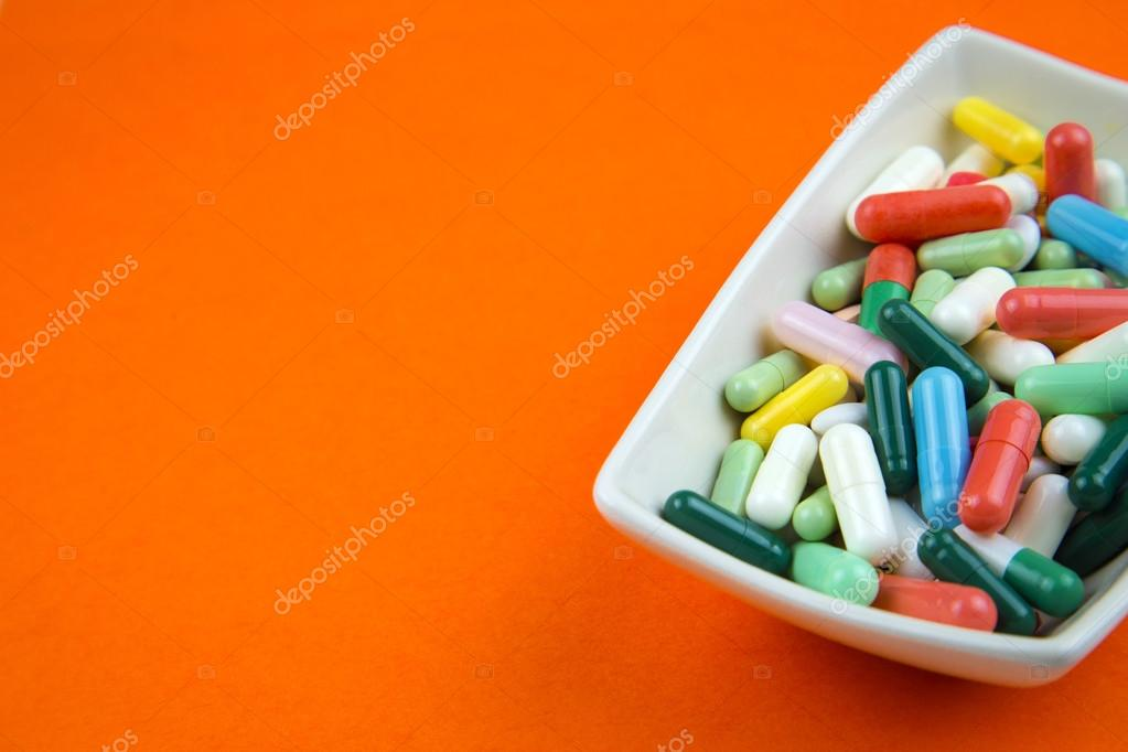 Lots Of Pills On Orange Background — Stock Photo © Hriana #78524106 Lots of pills on orange background — Stock Photo © Hriana #78524106 Orange Things orange 020 pill