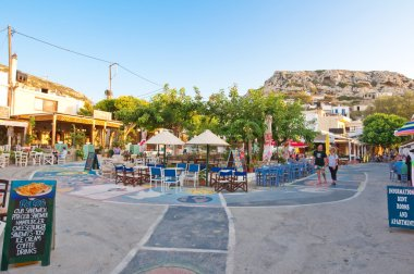MATALA,CRETE-JULY 22: Central square in Matala village on July 22,2014 on the island of Crete, Greece. Matala is a village located 75 km south-west of Heraklion, Crete.