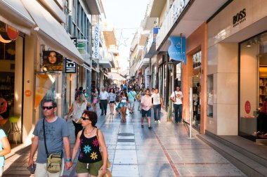 CRETE,HERAKLION-JULY 25: Shopping street Dedalou on July 25,2014 in Heraklion on the island of Crete, Greece. Daidalou Street is a paved pedestrian area lined with tourist shops.