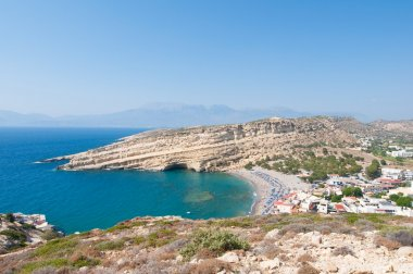 Panoramic view of Matala sandy beach and village on the island of Crete, Greece.