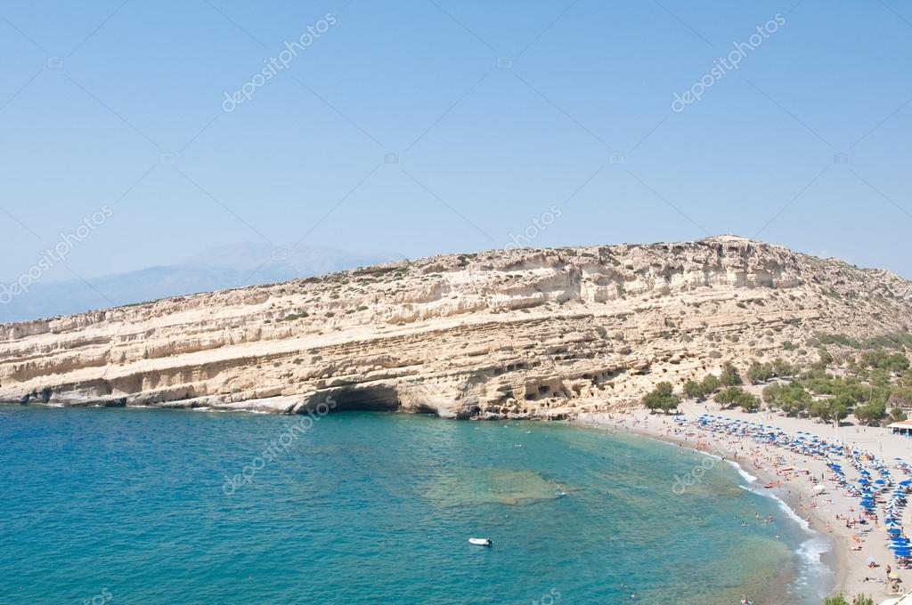 Matala hippy beach with caves on the Crete island, Greece.