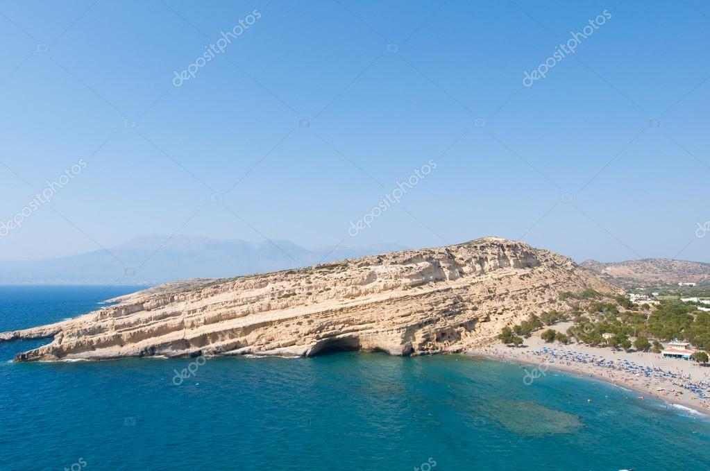 Panoramic view of Matala sandy beach with caves near Heraklion on the island of Crete, Greece.