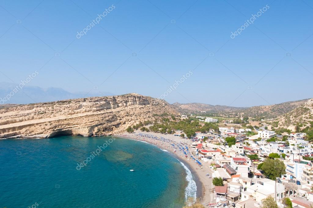 Matala sandy beach with caves near Heraklion on the island of Crete, Greece.
