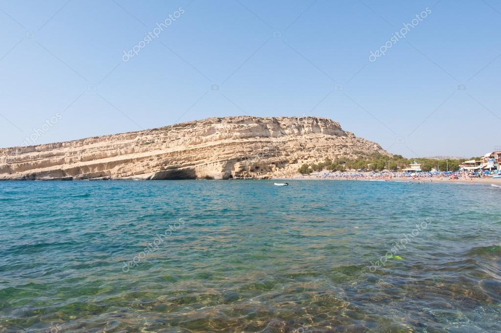 Famous Matala hippy beach with caves on the Crete island, Greece.