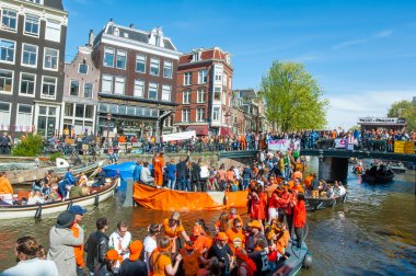 AMSTERDAM-APRIL 27: Locals and tourists on the boats participate in celebrating King's Day on April 27,2015 the Netherlands.