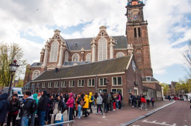People and tourists stand in a queue to Anne Frank House Museum, the Netherlands.