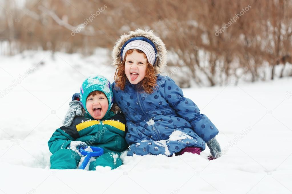 Happy children playing in the winter park.