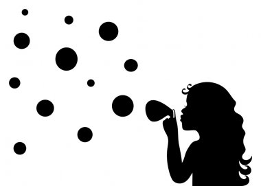 Silhouette of a little girl blowing soap bubbles on background o