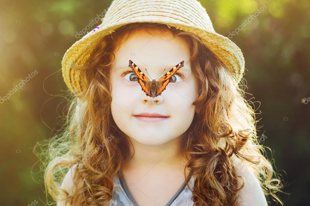 Surprised girl with a butterfly on her nose. Toning to instagram