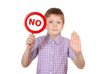Child with a sign prohibiting smoking, the concept of