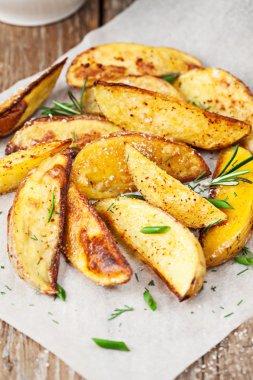 Baked potato wedges stock vector