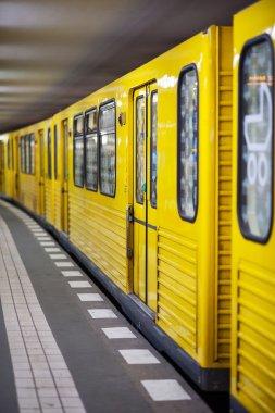 Yellow metro in subway station.