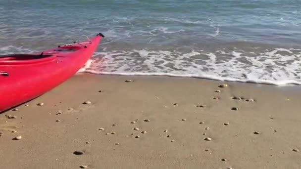 Canoe on a sunny beach.