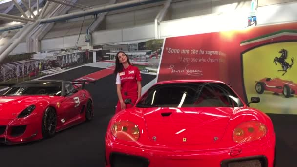 People visiting Motor Show Ferrari pavillion