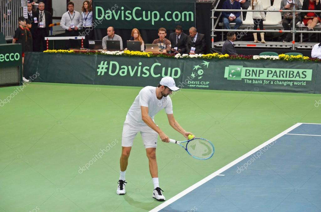 Irkutsk, Russia-Sept,19 2015: Konstantin Kravchuk serve. Davis Cup World Group Play-offs. Russia - Italy. Sports Palace 'Baikal-Arena', Irkutsk, RUS (hard - indoors)