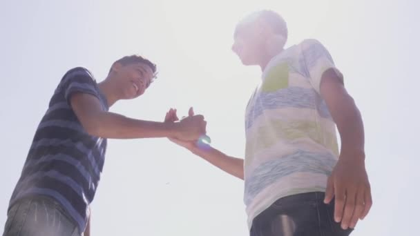 13-Slow Motion Hispanic And White Teenagers Shaking Hands