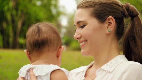 Happy Woman Holding Little Baby Smiling At Camera