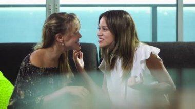 teenage-girls-whispering