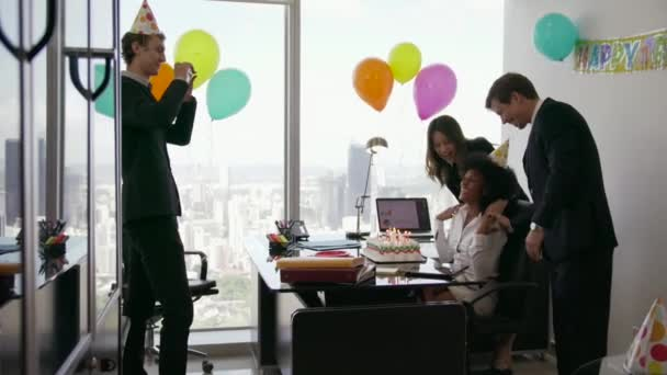2 Business People Celebrating Colleague Birthday Party In Office