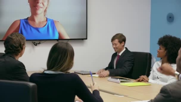 6 Business People In Office Meeting Room Doing Video Conference