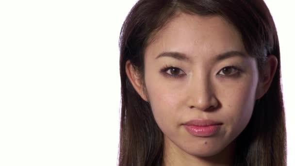 Emoce vážná smutná deprimovaná Asijská Japonská žena pohled na kameru