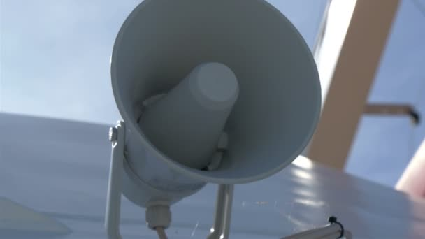 A white small megaphone attached on the yacht GH4