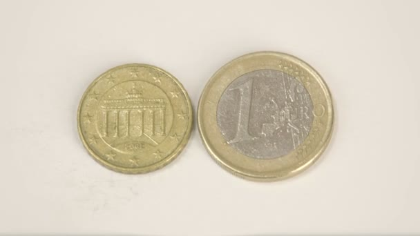 Showing the back detail of the smaller Germany coin and a 1 Euro coin