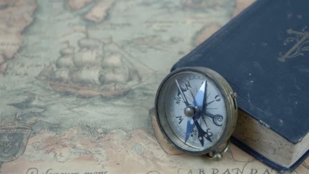 The compass beside a blue book