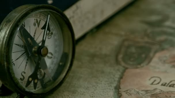 Left angle view of the compass and the book