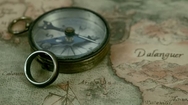 small compass and a ring