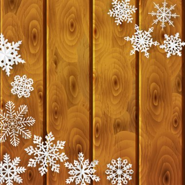 Christmas background with paper snowflakes on wooden planks