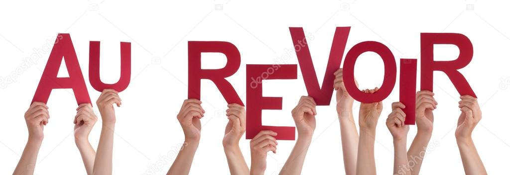 people holding french word au revoir means goodbye stock photo