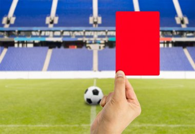 red card with stadium background
