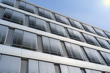 High-rise office building facade with covered windows Venetian b