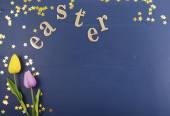 Fotografie Goldene Ostern Buchstaben auf Holz-Hintergrund