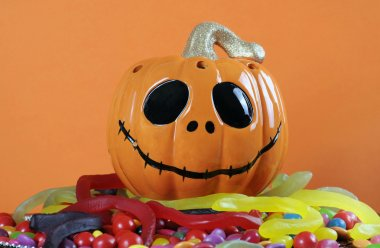 Halloween pumpkin with trick or treat candy.