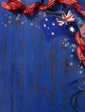 Australia Day background on dark blue wood