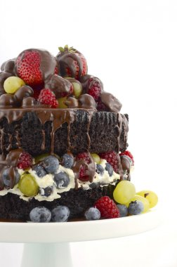 Deliciously divine chocolate cake with berries and cream.