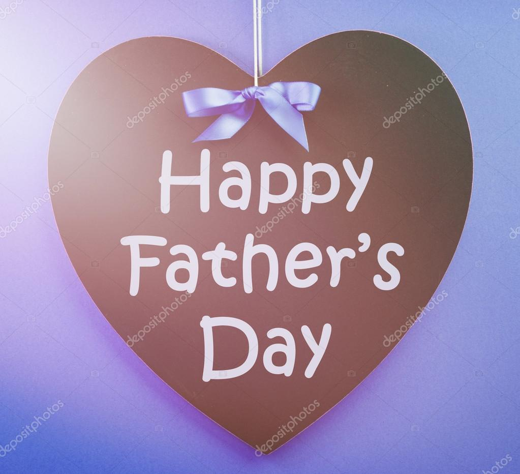 happy fathers day message written on a black blackboard with blu stock photo