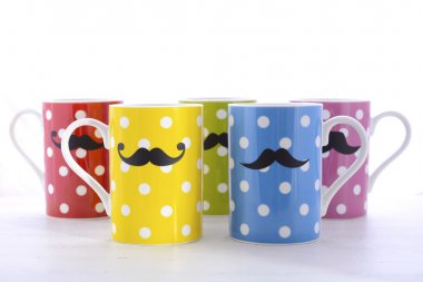 Colorful coffee mugs with mustaches.