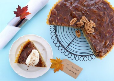 Traditional Thanksgiving Pecan Pie on Pale Blue Wood.