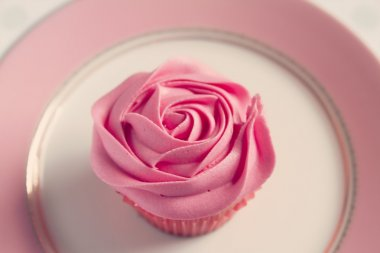 Overhead detail of pink rose frosted cupcake