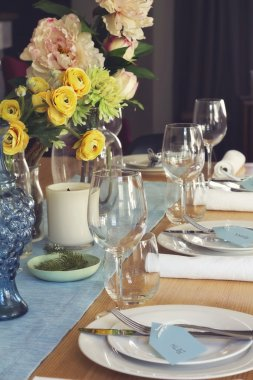 Formal table setting for lunch or dinner with flowers centrepiec
